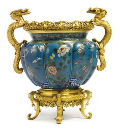 Attributed to Ferdinand Barbedienne 1810-1892 A French Chinoiserie gilt-bronze mounted cloisonné enamel centerpiece Paris, late 19th century height 16 in.; width 15 in. 41 cm; 38 cm