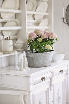 Love this all white kitchen with the pink hydrangea!