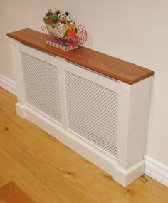 Is your home or apartment heated by old-school radiators? But these radiator units take up considerable wall space and, in many cases, they're unsightly. White Radiator Covers, Modern Radiator Cover, Contemporary Radiators, Traditional Radiators, Wall Heater Cover, Old Radiators, Cover Design, Teak, Home Furniture