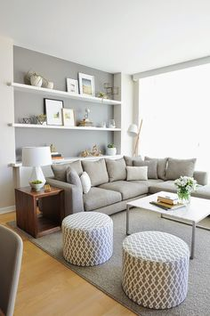love the accent wall with white shelving