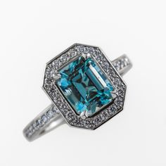 This breathtaking ring has been handcrafted in our Claremont workshop in platinum. It has been set with one emerald cut aquamarine and 40 round brilliant cut diamonds totalling combined wieght, colour: f, clarity: Emerald Cut Aquamarine Ring, Oval Diamond, Diamond Bands, Diamond Cuts, Stone Earrings, Stone Bracelet, Stone Jewelry, Coloured Stone Rings, Alternative Engagement Rings