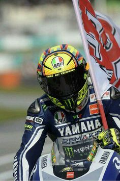 Valentino rossi flying a marco simoncelli flag as a tribute to his friend after the 2013 sepang race Motogp Valentino Rossi, Valentino Rossi 46, Grand Prix, Vale Rossi, Rossi Yamaha, Italy Images, Vr46, Racing Motorcycles, Biker Chick