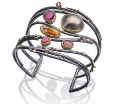 The Sunset cuff, inspired by the colors of a beautiful Tulum sunrise.  Sea of Cortez pearl with tourmalines, spessartite, rhodonite. http://www.sydneylynch.com/project/sunset-twig-cuff-wholesale-2/