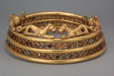 Torque (Grivna)        Epoch. Period: Early Iron Age  Date: Sakae Culture. 5th - 4th century BC  Archaeological site: Russia, Siberia       Material: gold, turquoise and corals  State Hermitage Museum