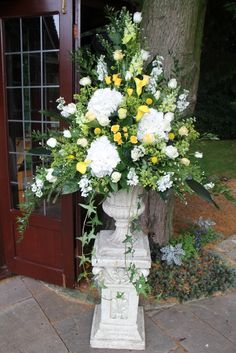 A magnificent pedestal design of Antirhinnum, Stocks, Roses, Hydrangeas, Calla Lilies and September Flower