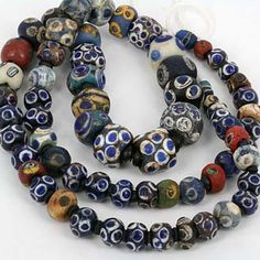 Collection of ancient Mosaic Glass Eye Beads from the Islamic world & beyond. Largest central bead measures 12 x 10.70mm material: Mosaic Glass. origin: Mixed Western & Central Asia. condition: Worn Robust Pre-Loved Condition. cutting: Mostly Spheroid Shape