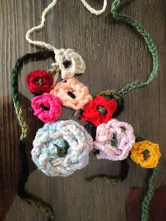 Double finger knitted flowers.