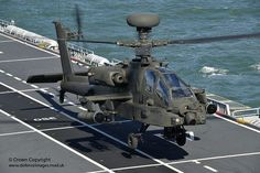 An Army Air Corps Apache attack helicopter takes off from the deck of the Royal Navy's amphibious assault helicopter carrier HMS Ocean