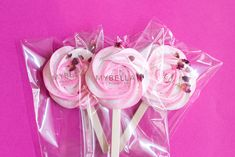Meringue rose pops from Mybella Meringues with edible rose petals. A sweet gift for Valentine's Day.
