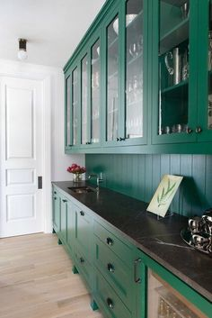 There are a ton of different ways to bring shiplap wall paneling into your kitchen design, whether you want a neutral paneled look or one with heaps of trendy color. #hunkerhome #shiplap #shiplapideas #kitchenshiplap Green Cabinets, Upper Cabinets, Pantry Design, Kitchen Design, Kitchen Ideas, Kitchen Pantry, Pantry Lighting, New England Farmhouse, Cocinas Kitchen