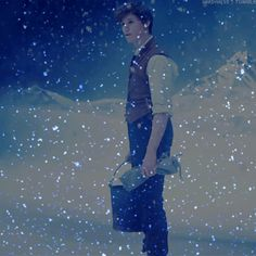 Newt lost in reverie in a snowscape - Merry Christmas!! gif