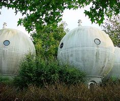 Bolwoningen Houses, Hertogenbosch, Netherlands  If Lewis Carroll's Alice wandered into a 1960s sci-fi flick, she might have come across something like these bulbous houses. The residents live inside bizarre-looking bubbles (small ones, at 18 feet across) with UFO-like windows.
