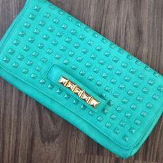 Mint studded clutch Gorgeous studded clutch with gold hardware. This is brand new, never worn. There are 2 small scratches on 2 different studs. This also comes with a cross body strap. This was in the markkit collection of a YouTube style blogger. Markkit Bags Clutches & Wristlets