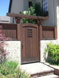 31 Creative Fence Gate Ideas For Your Home 2020 - A Nest Wit.- 31 Creative Fence Gate Ideas For Your Home 2020 – A Nest With A Yard wooden gate in the middle of a brighter colored fence - Wood Fence Gates, Fence Gate Design, Wooden Garden Gate, Garden Gates And Fencing, Privacy Fence Designs, Wooden Gates, Garden Doors, Arbor Gate, Dog Fence