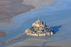 Here's a day trip from Paris that takes you to Mont Saint-Michel, the fairytale island just off the Normandy coast. Stay In A Castle, Day Trip From Paris, Walled City, Mont Saint Michel, Tourist Information, French Countryside, Vacation Places, Dream Vacations, Inevitable
