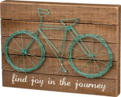 This unique string art bicycle sign is a perfect accent piece for any room in your home or vacation getaway!
