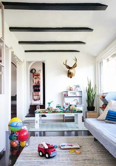 A Sophisticated Playroom + Get The Look - Emily Henderson - CheekyTummy - A Sophisticated Playroom + Get The Look - Emily Henderson Suzanne's Sophisticated Childrens Playroom Makeover Neutral Kids Blue Grey Emily Henderson. Sunroom Playroom, Playroom Storage, Playroom Design, Playroom Decor, Playroom Ideas, Colorful Playroom, Toy Storage, Kitchen Storage, Office Decor