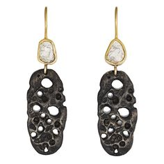 Julie Cohn Design: Diamond Slice Coral Earrings. Cast in silver and oxidized, these earrings hang from a bezel set diamond slice attached to an earwire. Available in 18kt and 14kt gold.