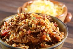 This flavorful Spanish rice is made with ground beef, rice, onion, chili sauce, bacon, sugar, and green bell pepper.
