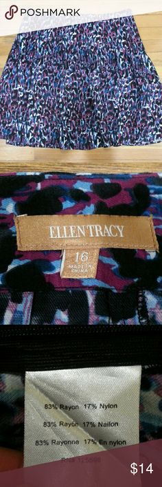 "Ellen Tracy Skirt Soft fluid rayon nylon skirt has side zip close. Darted waistband for flattering fit. Approximately 24"" long, waist 19"" seam to seam laying flat. Excellent condition. Black, burgundy and blue print. Ellen Tracy Skirts"