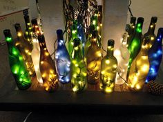 One clear frosted, lighted wine bottle featuring a black heron silhouette painted on the front center of the bottle. Wine Bottle Art, Lighted Wine Bottles, Bottle Lights, Wine Bottle Crafts, Painted Bottles, Gifts For Wine Lovers, Wine Gifts, Silhouette Painting, Battery Operated Lights