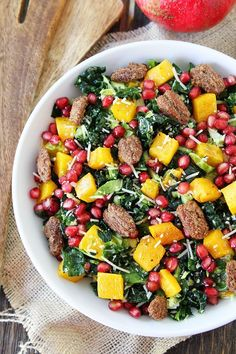 Kale and Brussels Sprouts Salad with Butternut Squash, Pomegranate, and Candied Pecans Recipe on twopeasandtheirpod.com Love this healthy salad!