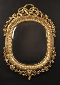 A Fine Louis XV Style Carved Giltwood Mirror French, Circa