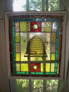 Stained glass panel with honeybee design.