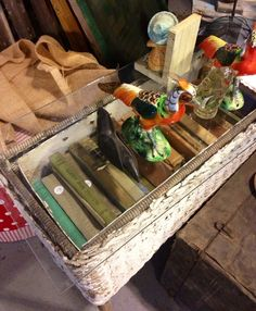 Old box filled with antique books. Glass laid on top to make a small table. Beautiful!