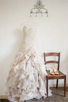 Modern ivory wedding dress features tailored ruffled organza skirt, cascaded ruffled skirt flows with tiered design, strapless sweetheart bodice is hand ruched design, back lace up and spaghetti straps are attached.