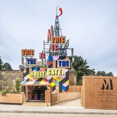 Designer Morag Myerscough added more than a splash of colour to the site by fixing painted wooden boards to the upper scaffolding structure carrying the words of a poem-tweet by Olympic bard Lemn Sissay...