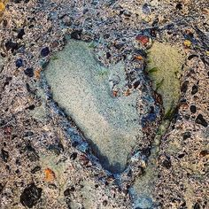 Split-rock heart, open/to breaking waves, wind, sand, salt/rising ocean tides. #haiku #heartshaped #climateaction #mylagunabeach