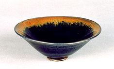 "from the Kyoto Museum, a Teabowl with Brown and Black Glaze (Honan Tenmoku). In Japanese, the word for bowl is chawan, and most Japanese people use chawan every day to eat rice. The word chawan, however, does not mean ""rice bowl,"" but ""teabowl."" This is because such bowls were originally used, not for rice, but for tea!"