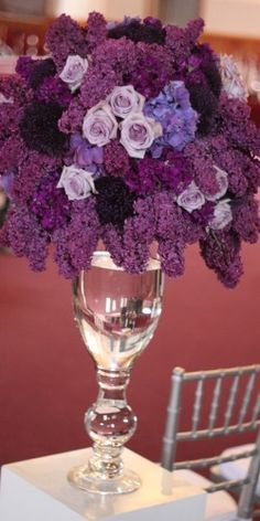 lilacs will totally be in season for your wedding!!! They're the deep purple clustery flower you see up above...dramatic displays and uber fragrant