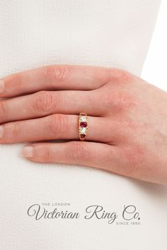 This ruby and diamond half hoop ring has been expertly carved in the Victorian style.The ring is set with three oval/cushion-shape rubies alternating with two Victorian/Old-cut diamonds. Eight diamond points are set either side of the larger gemstones.All rings are true to the original designs of their era. All gemstones are natural.