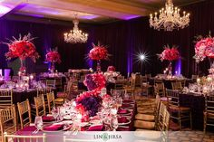 http://calligraphybyjennifer.net/blog/langham-pasadena-indian-wedding/- chandys and florals really stand out vs midnight blue drapery panels