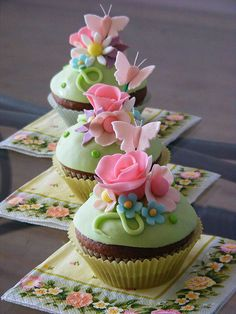 Towering, joyfully pretty flower and butterfly topped springtime cupcakes. #wedding #cake #cupcakes #flowers #butterflies #dessert #pink #food