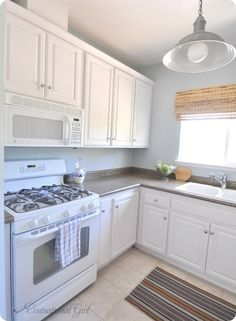 Mini kitchen makeover tutorial on painting cabinets white with rustoleum kit kitchens with white appliances, Painting Kitchen Cabinets White, White Kitchen Appliances, Mini Kitchen, New Kitchen, Home Kitchens, Tiny House Kitchen, Kitchen Renovation, Kitchen Cabinets Makeover, Kitchen Design