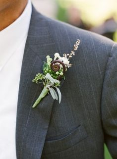 White Flower Wedding Boutonniere.  Like the fiddlehead fern; nice garden wedding touch for guys.