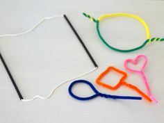 Make pipe cleaner bubble wands and big bubbles