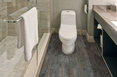 Use this guide to the hottest 2019 bathroom flooring trends and find durable, stylish bathroom flooring ideas that will stay trendy for years to come. Wooden Bathroom Floor, Vinyl Flooring Bathroom, Best Bathroom Tiles, Vinyl Tiles, Bathroom Trends, Diy Bathroom Decor, Bathroom Interior, Bathroom Carpet, Plank Flooring