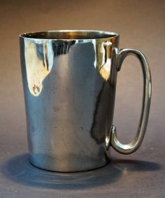 One-pint silver-plated pewter mug, stamped 'W Loftus 321 Oxford Street' and engraved on the bottom 'Sloanes Head New St Brompton Rd'. Loftus was a well-known pewterer, and also a 'Hydrometer, Saccharometer, and gauging instrument maker, to the Government, and manufacturers of bottling and corking machines and all utensils for the spirit and brewing trades'. He was based at 321 Oxford Street from around 1880 to around 1900. The Sloanes Head was at 16 New Street from at least 1839, when it was…