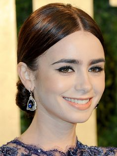 Lily Collins' top 10 hair and makeup looks: Vanity Fair Oscar party, 2013 http://beautyeditor.ca/2013/10/02/lily-collins-makeup-and-hair/