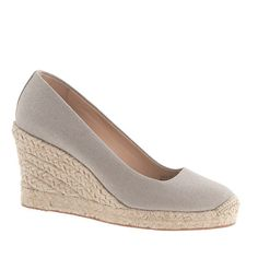 """Wedges: how to do heels without the heel. We made this pair in a special canvas with a hint of metallic shimmer, so they're even more irresistible than usual. <ul><li>3 3/4"""" jute heel with an exterior platform for extra comfort.</li><li>Canvas upper.</li><li>Leather lining.</li><li>Import.</li></ul>"""