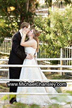 Bride And Groom Pose For A Formal Portrait Photo On The Bridge At Rockin