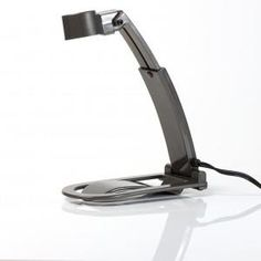 """Fun fact! Our most popular Zelco product, the """"itty bitty"""" book light, was dreamed up one night when Noelle Seller and his wife Adele were in bed and she wanted to sleep while he wanted to read. He decided to design a tiny light that clipped onto a book and only lit one page at a time. The perfect product for late night marital success!"""