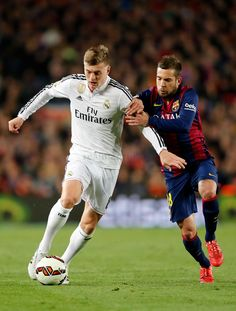 Toni Kroos of Real Madrid competes for the ball against Jordi Alba of FC Barcelona during the La Liga match between FC Barcelona and Real Madrid CF at Camp Nou on March 22, 2015 in Barcelona, Spain.