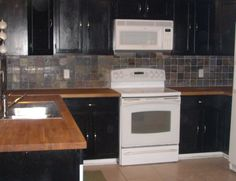 furniture-white-microwave-above-white-stove-for-black-wooden-cabinet-with-oak-butcher-block-countertops-and-kitchen-tiles-for-backsplash-ideas-butcher-block ...