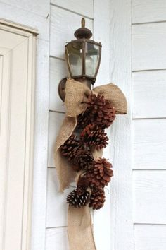 Burlap ribbon and pinecones wired together by camie1
