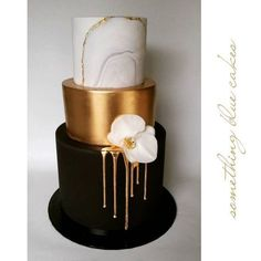 Today's cake made for a private function provided modern themes and stark contrasts. Black gold and marble
